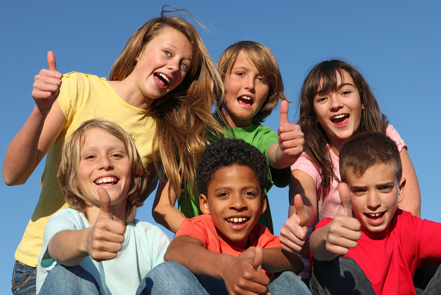 group of diverse kids or children with thumbs up